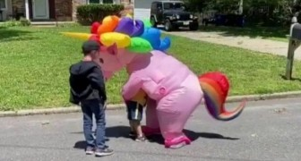 Grandmother dresses up in unicorn blowup costume so she could hug her grandchildren during Covid