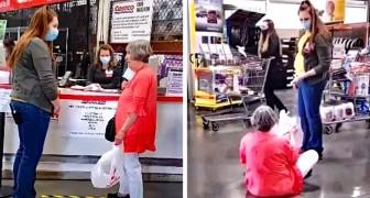 """Een vrouw zit in een winkel op de grond en heeft een """"driftbui"""" omdat ze haar vragen een masker te dragen"""