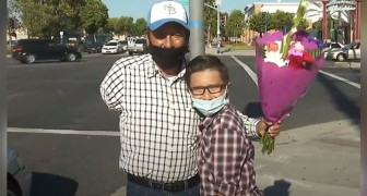 A 9-year-old helps raise $20,000 for a man with one arm, who sells flowers for a living