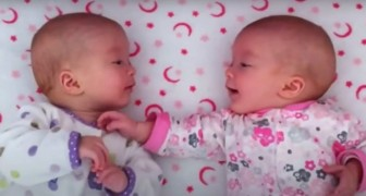 A mother films her 2 twins who chat amiably as if they were old friends