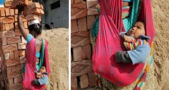 Uma mãe carrega 6 tijolos na cabeça enquanto segura seu bebê de alguns meses: uma foto de partir o coração