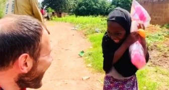 An orphaned girl receives her first doll: the video of her reaction is nothing short of touching