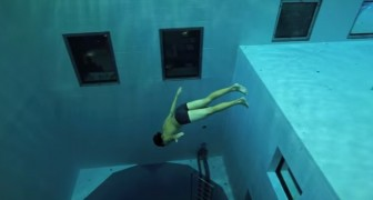 A man dives in one of the deepest pools in the world. AWESOME !