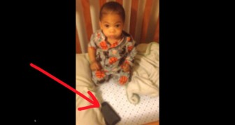 They put a cell phone next to the sleeping child: his reaction is HILARIOUS!