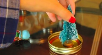 She glues a small tree on the lid of a jar. The result? AWESOME !