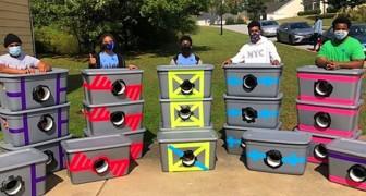 Un gruppo di ragazzi costruisce dei rifugi fai-da-te per i gatti randagi del quartiere: un aiuto contro il freddo
