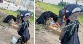 Obdachloser Mann kümmert sich um behinderten Hund: füttert ihn und betrachtet ihn als 'sein Baby'