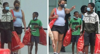 Two orphans try to sell candy to a passerby: she buys them lunch and takes them to the mall