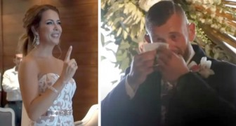 The bride stops half way down the aisle and sings a song to her deaf husband in sign language