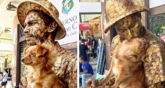 A dog remains motionless like a statue together with his street artist master: now they are real stars