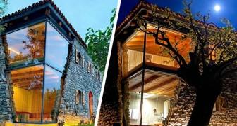 Questa casa è stata ricostruita con una spettacolare parete in vetro che sembra uscire dalla pietra