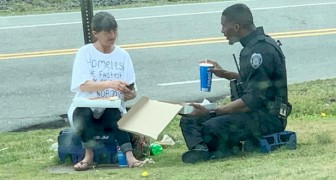 A police officer buys a pizza and shares it with a homeless person: the photo goes viral