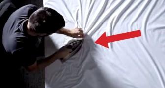 En utilisant seulement un drap et un fer à repasser, cet artiste vous étonnera!