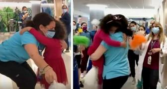 En 5-årig flicka blir frisk från cancer och springer för att krama om sin favoritsjuksköterska - den rörande scenen