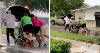 Quattro uomini spingono un'anziana sullo scooter per 1 km: si era bloccato mentre stava piovendo a dirotto