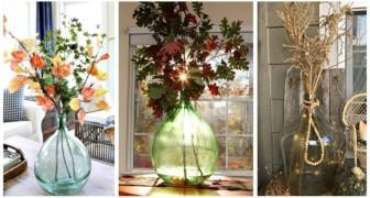 Composizioni autunnali per decorare la casa? Usa i rami più colorati dentro alle damigiane!