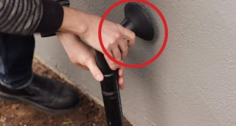 He puts a fake pipe beside the house door. Why? You'll be surprised !