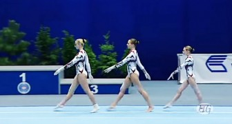 3 gymnasts begin their performance and the audience is amazed by their skill