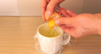 He breaks an egg in a strip of cling film and shows you an AMAZING trick !