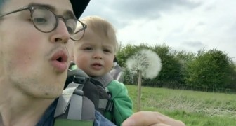 Dad is about to blow on the flower, but the reaction of his son takes him by SURPRISE!