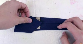 He starts by folding a tie ... the end result will give you a touch of STYLE!