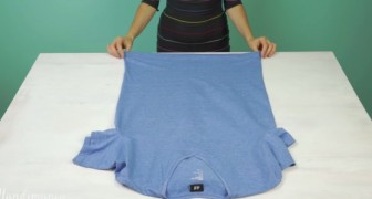 Here's how to fold a T-shirt while saving space and avoiding creases. BRILLIANT!