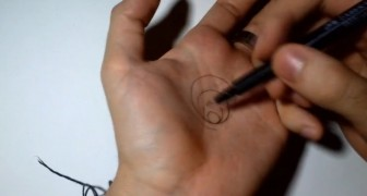 He start by drawing a circle on his hand but the final effect is stunning !
