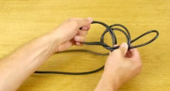 He start by making a loop with a cable and shows you how to solve a very annoying problem