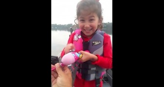 She is fishing with a Barbie fishing rod, but what she pulls out of the water will make them scream!
