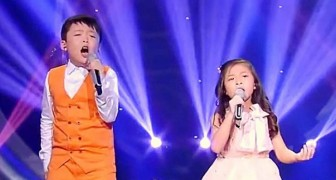 The boy's voice is beautiful, but when she joins the audience is speechless!