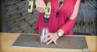 Elle commence à perforer des verres en plastique... ce qu'elle réussit à faire est incroyable!