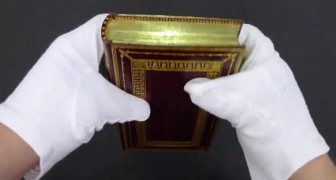 This librarian bends the pages of an old book and reveals an ancient and spectacular secret