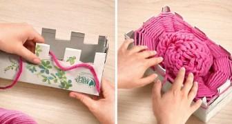 Come creare una sciarpa utilizzando la lana e due scatole di cartone