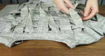 She seems to make random cuts in a long-sleeved t-shirt --- but the final results are rather interesting!