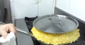 Combine fried potatoes and 30 eggs --- Result?--- One 26 lb. omelette!