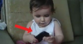 Minder dan 2 jaar en pakt de telefoon al in handen: wat ze dan doet zal je doen schaterlachen!