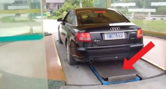 A man parks his car in China --- keep your eye on the platform!