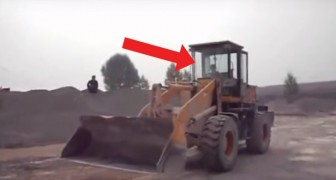 A wheeled loading shovel truck is moving --- but who is driving it?