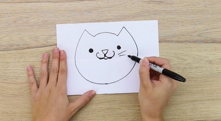 Il dessine un chat sur une feuille pliée en deux: quand il l'ouvre, ça va vous faire rire!