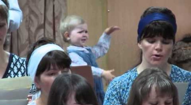 The little girl who directs the choir