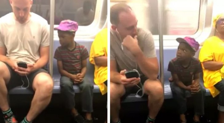A young boy continues to peek at a man's smartphone, so he gives it to the boy and allows him to play instead