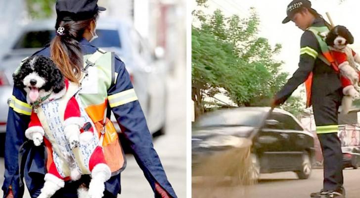 En gatustädare in Bangkok bär sin hund på ryggen medan hon städar stadens gator