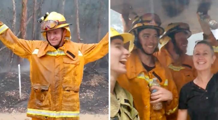 Piove in Australia: i pompieri impegnati a domare i gravi incendi celebrano l'evento ballando di gioia
