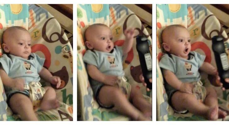 A reação de um bebê diante do controle remoto