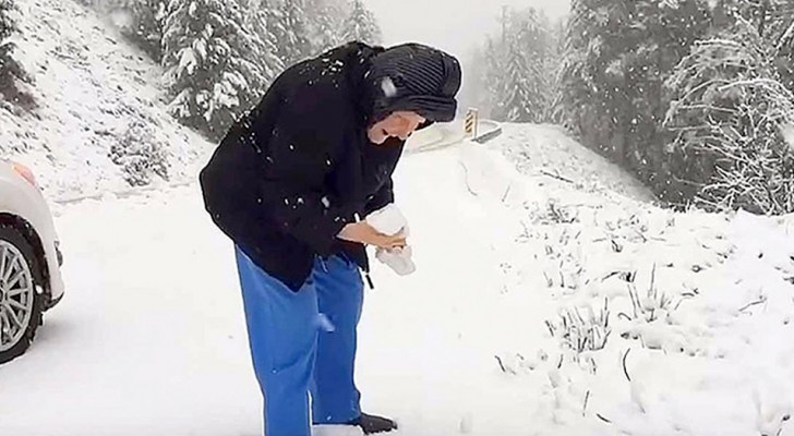 This 101-year-old woman asks her son to stop his car and starts playing in the snow like a little girl