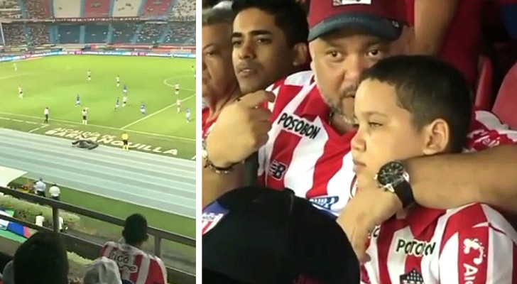 Den här pappan tar med sin blinda son till stadion, håller honom under armen och förklarar hur matchen går