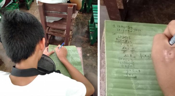Cet élève n'avait pas d'argent pour un cahier, alors il a utilisé des feuilles de bananier pour écrire ses notes