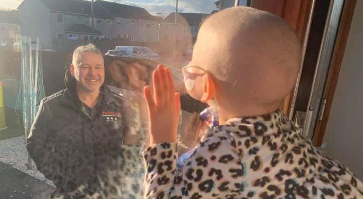 Das Mädchen mit dem Tumor, das dem Papa durchs Fenster winkt, symbolisiert die Bedeutung der Isolation gegen Covid-19