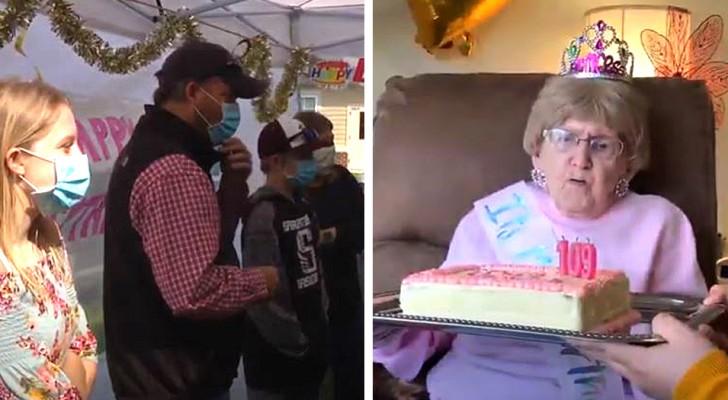 Een vrouw wordt 109 in isolatie in een verpleeghuis: de kinderen en kleinkinderen vieren haar achter het raam