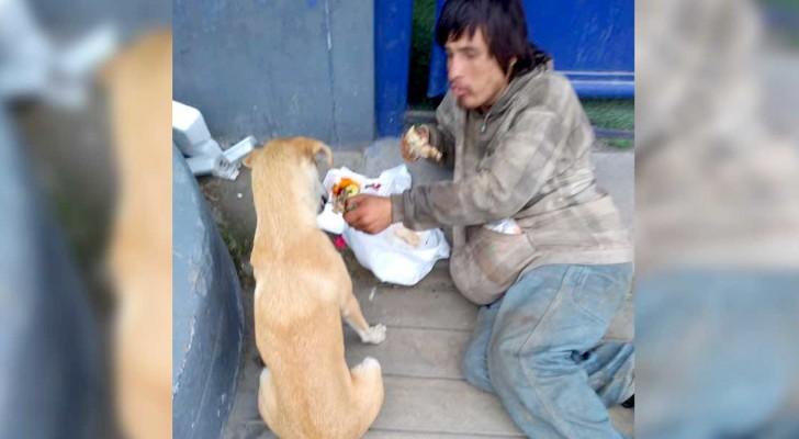 Um mendigo dá parte de sua refeição para um cachorro de rua: quem tem pouco é realmente mais altruísta